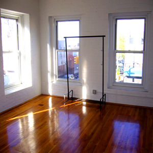 bedroom in loft apartment in park slope brooklyn on 5th ave. with wood floors and tin ceiling 11215 for rent